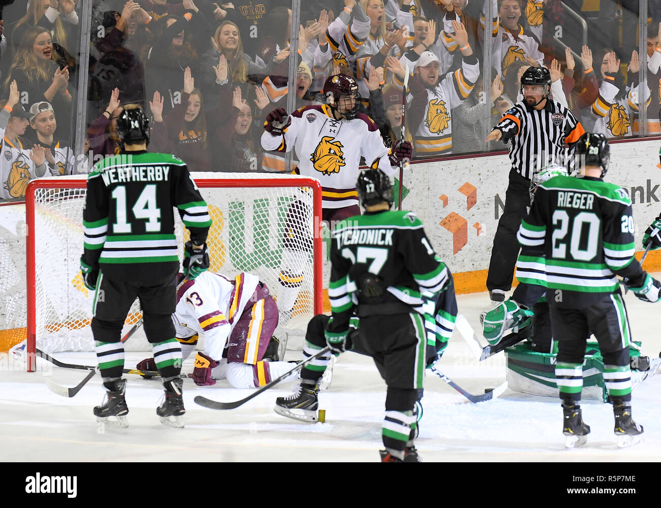 December 1, 2018 Players look to the referee as he signals a Minnesota Duluth goal during a NCAA men's ice hockey game between the University of North Dakota Fighting Hawks and the Minnesota Duluth Bulldogs at Amsoil Arena in Duluth, MN. North Dakota won 2-1. Photo by Russell Hons/CSM Stock Photo