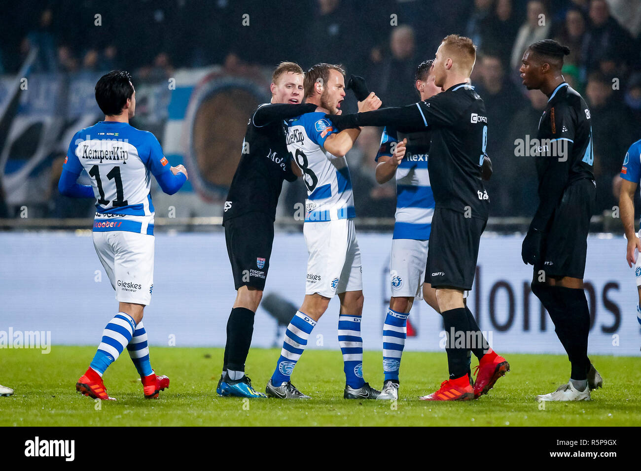 DOETINCHEM, De Graafschap - PEC Zwolle 0-2, football, Eredivisie, season 2018-2019, 01-12-2018, Stadium De Vijverberg, commotion on the field, De Graafschap player Frank Olijve (M) fighting with PEC Zwolle player Mike van Duinen (2R) - Stock Image