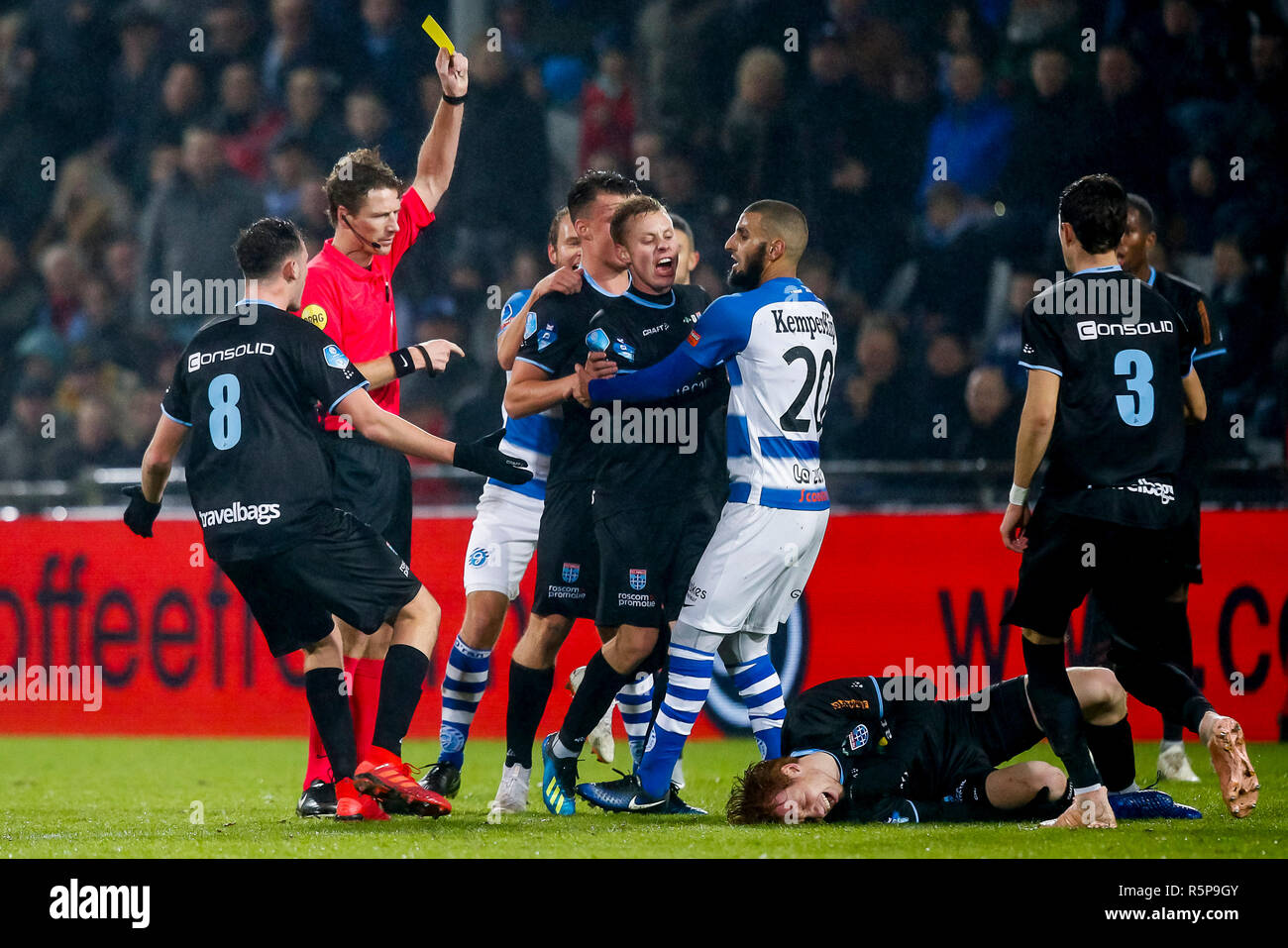 DOETINCHEM, De Graafschap - PEC Zwolle 0-2, football, Eredivisie, season 2018-2019, 01-12-2018, Stadium De Vijverberg, commotion on the field, referee Martin van den Kekrhof (2L) gives a yellow card to De Graafschap player Youssef El Jebli (M) - Stock Image