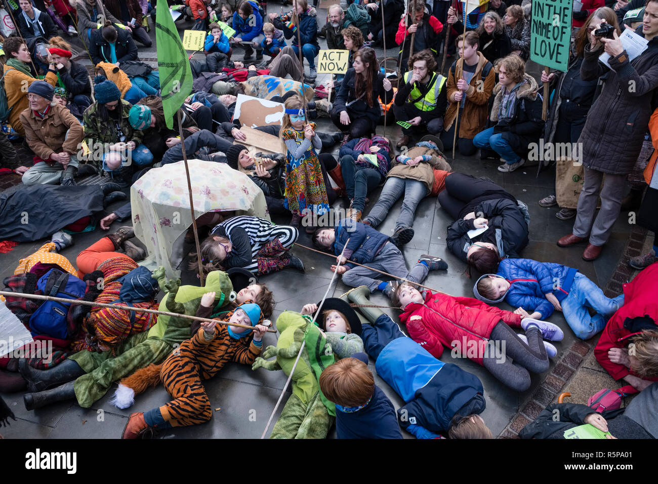 Hereford, UK. 1st December, 2018. Local children stage an 'extinction event' or die-in at a demonstration organised by the Extinction Rebellion movement (climate change activists) in this old cathedral city . Credit: Alex Ramsay/Alamy Live News - Stock Image