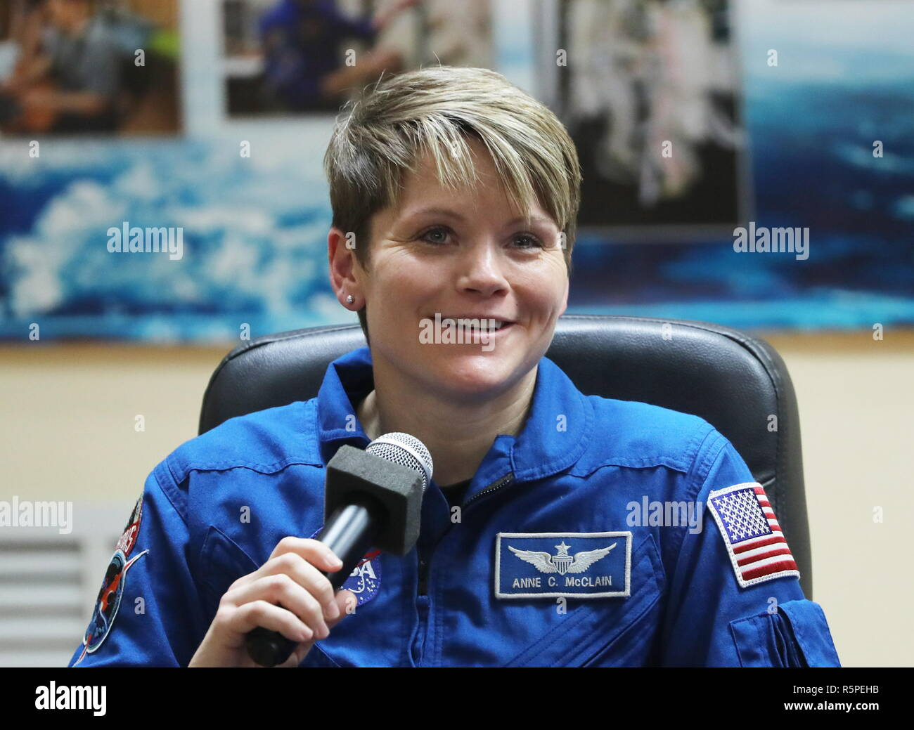 Baikonur, Kazakhstan. 02nd Dec, 2018. KAZAKHSTAN - DECEMBER 2, 2018: ISS Expedition 58 crew member, NASA astronaut Anne McClain of the United States, at a pre-launch press conference at the Baikonur Cosmodrome; the launch of the Soyuz MS-11 spacecraft crew to the International Space Station (ISS) is scheduled for December 3, 2018, 14:31 Moscow time. Sergei Savostyanov/TASS Credit: ITAR-TASS News Agency/Alamy Live News - Stock Image