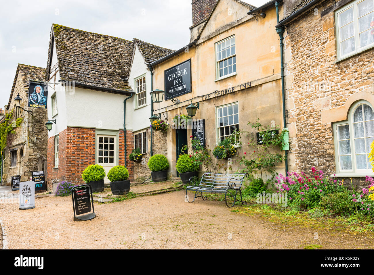 The George Inn in Lacock Village, Wiltshire. A Wadworth Brewery English pub. - Stock Image