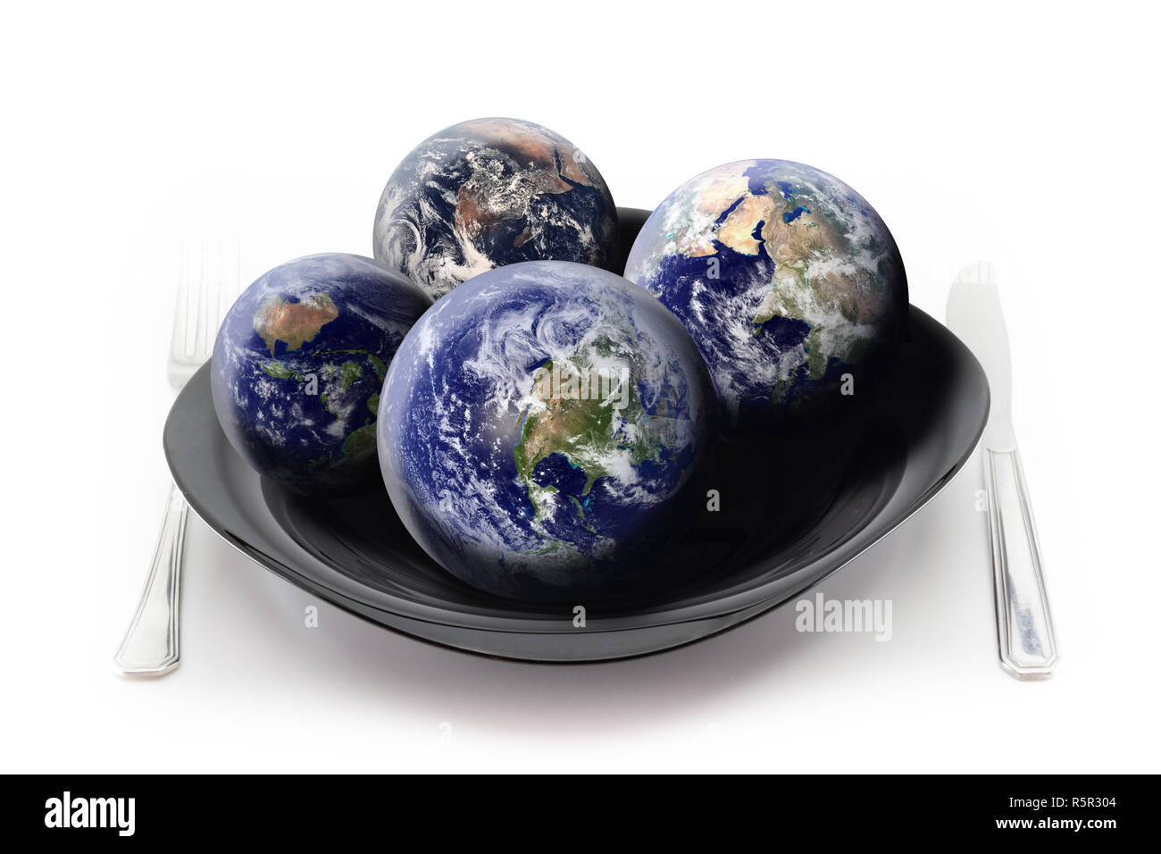 How many Earths do we need to satisfy our hunger? Concept about the overuse of our Planet. Isolated composite image made of a black china plate with c - Stock Image