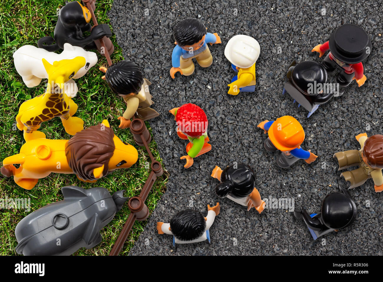 Artificial vs. natural habitat concept. People in artificial environment outplace wild animals living in nature. It is only the point of view, whether - Stock Image