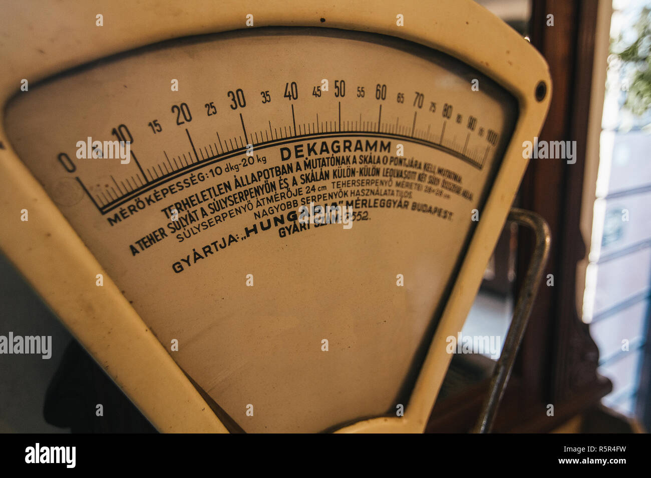 Vintage golden weighing scales as a part of restautant interior - Stock Image