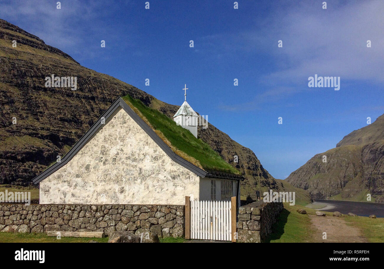 Small white church with a grass roof at Saksun in the north of the Faroe Islands Stock Photo