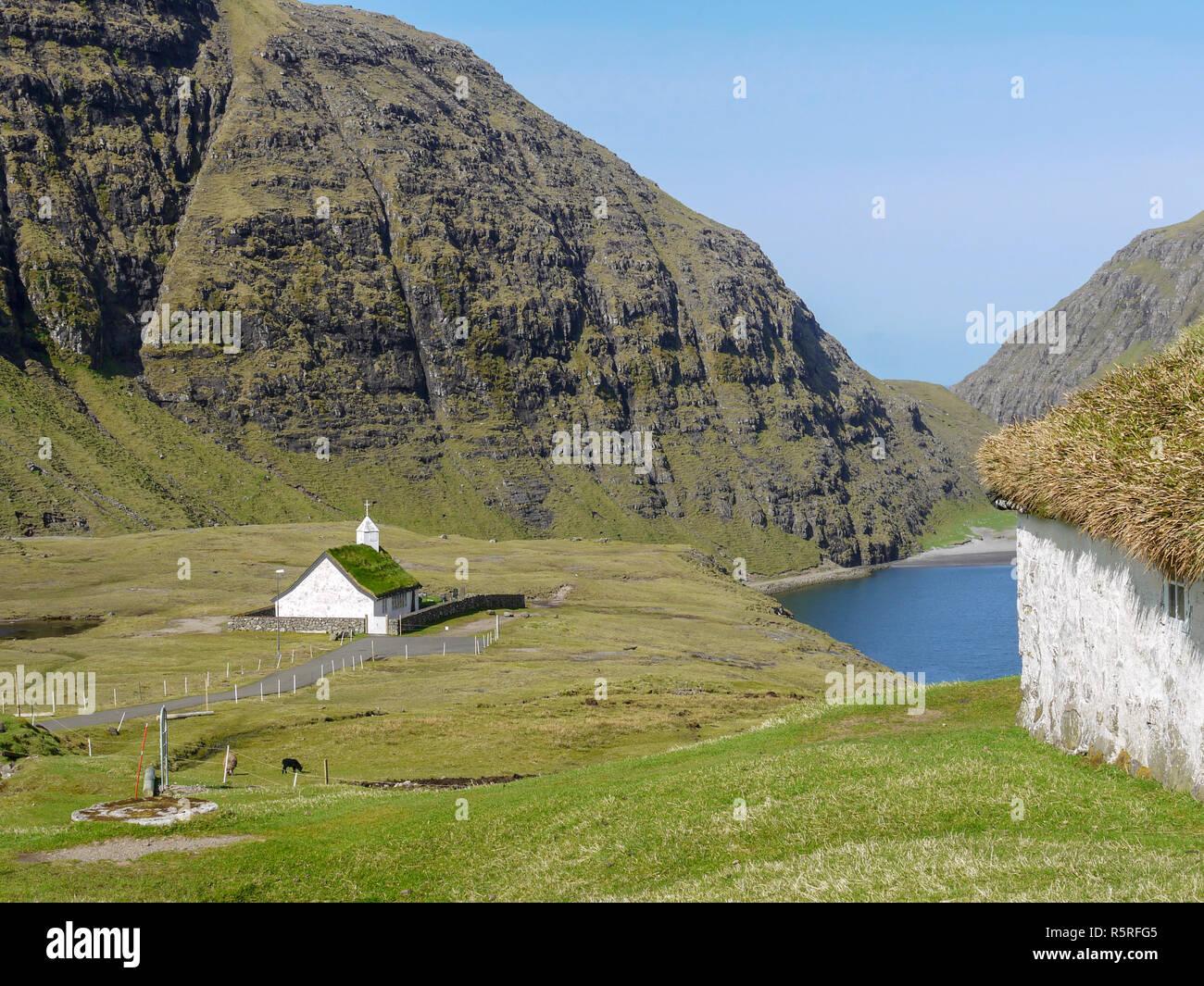 White church at Saksun on the sea near the north end of the main island of the Faroes Archipelago Stock Photo
