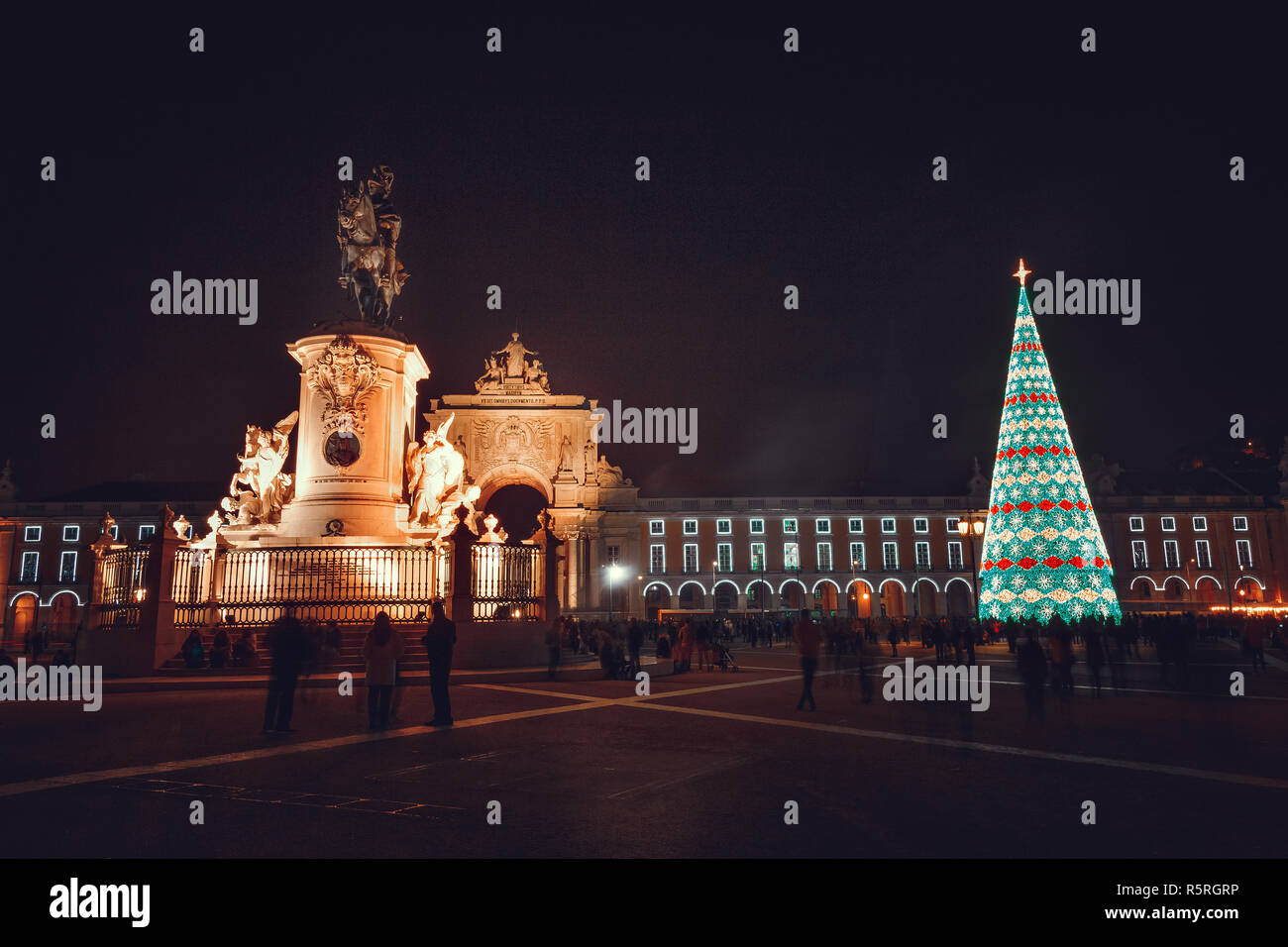 Christmas tree on Commerce square at night in Lisbon, Portugal Stock Photo