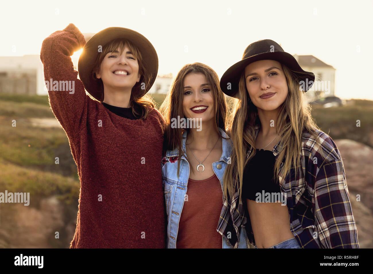 Three Best Friends Near The Coastline Having A Good Time Stock Photo Alamy