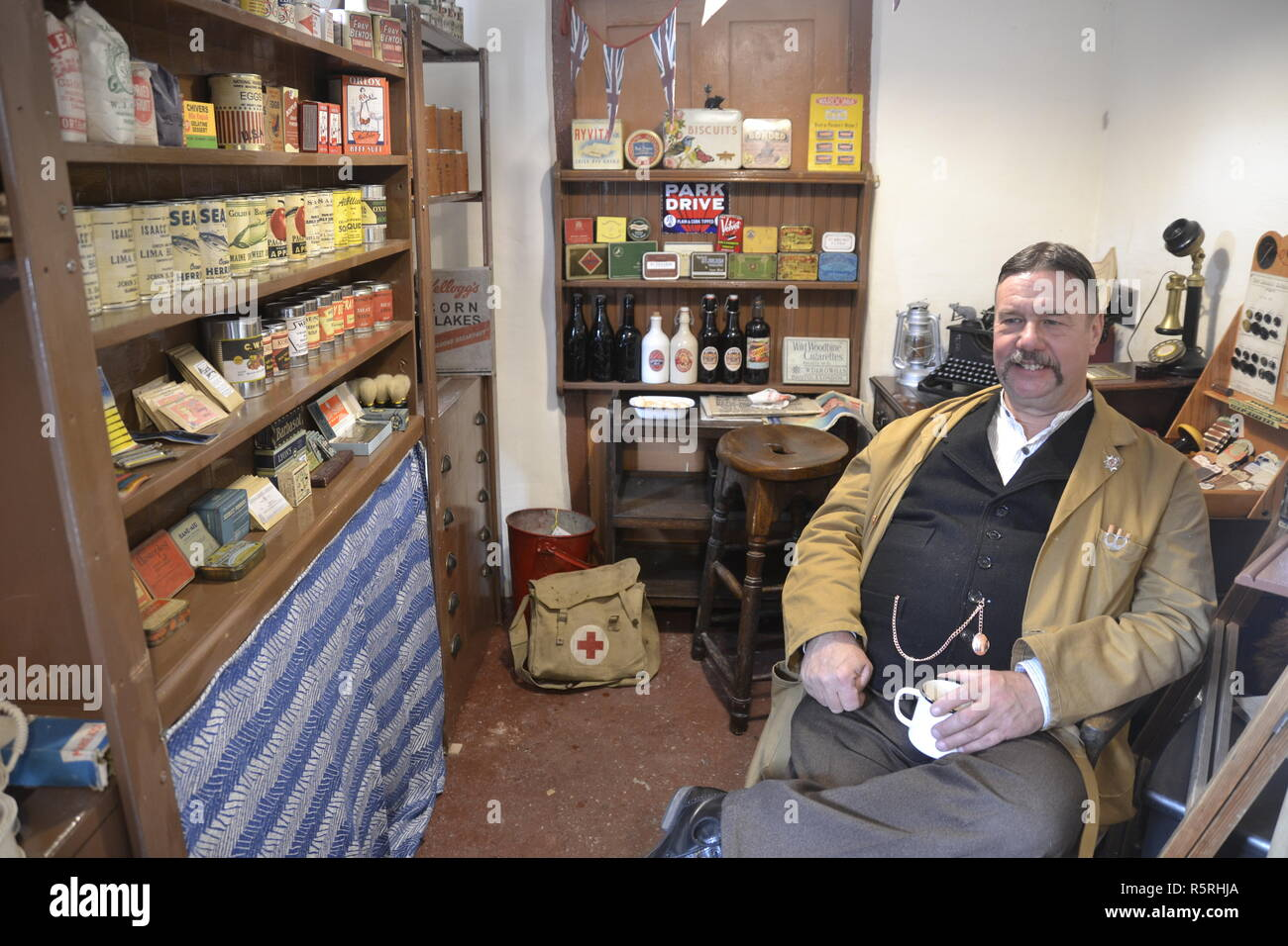 Shop keeper at the 1940s Weekend on West Somerset Railway, Watchet, UK - Stock Image