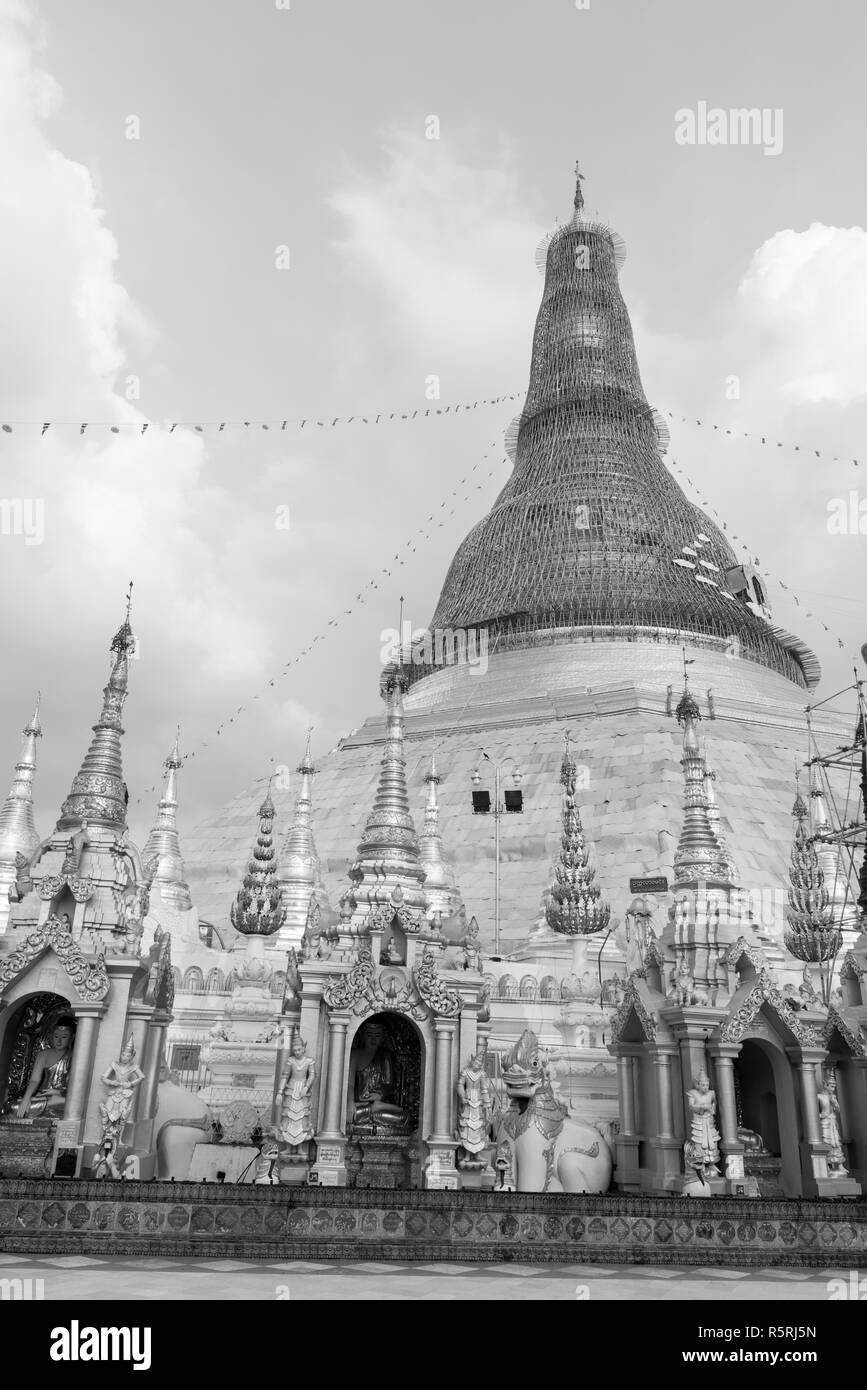Black and white picture of huge Shwedagon Pagoda, important landmark of Yangon, Myanmar - Stock Image