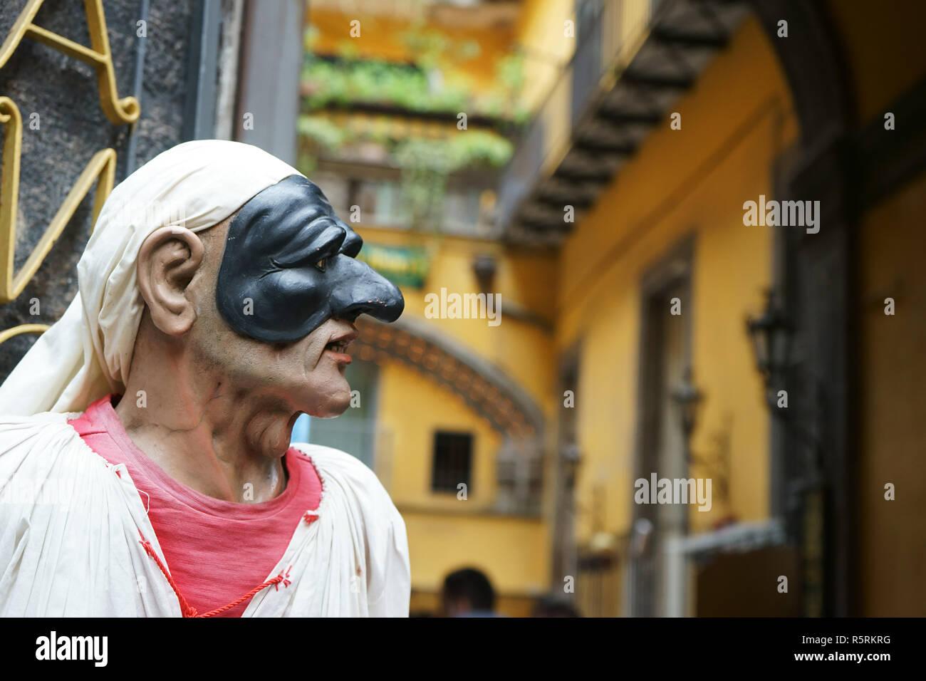 Pulcinella traditional neapolitan mask, in Via San Gregorio Armeno, historic center of Naples, Italy - Stock Image