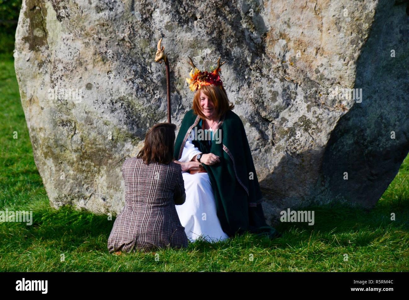 Transvestite Druid doing a blessing at Avebury Henge - Stock Image
