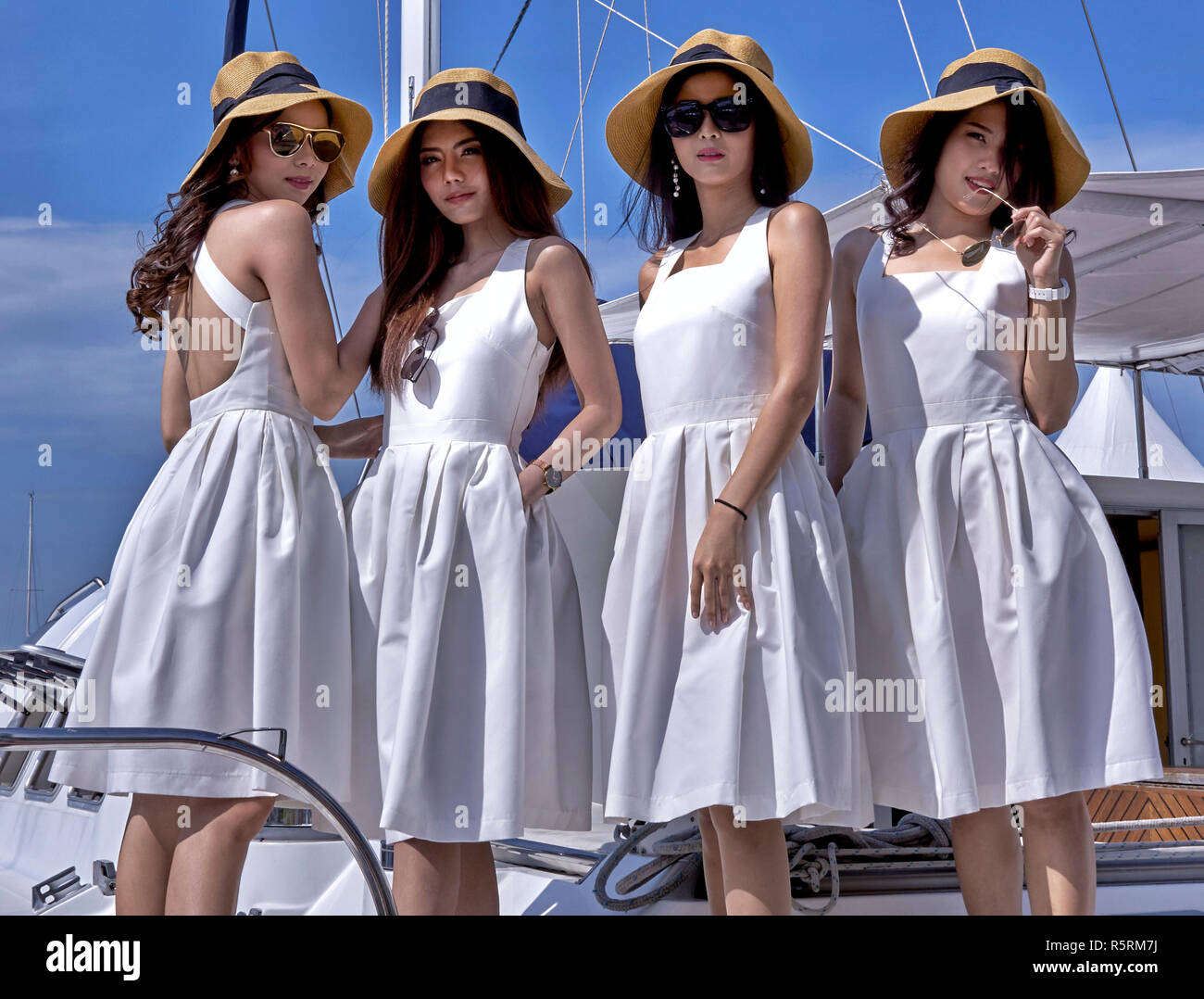 Models posing on a luxury yacht at the Pattaya boat show 2019, Thailand Southeast Asia - Stock Image