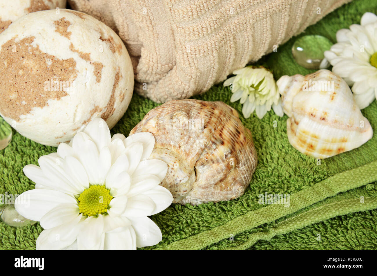 Towel, chamomiles  and bath bomb for relaxation - Stock Image