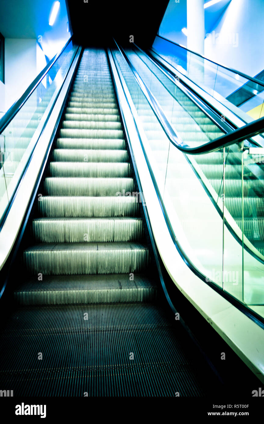 empty escalator in a mall, view from below - Stock Image