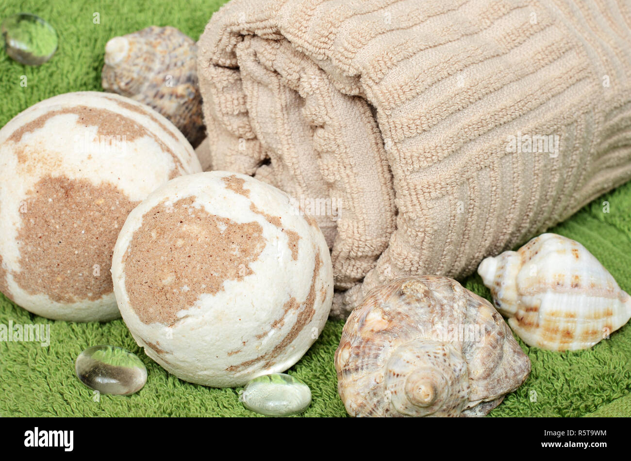 Towel and bath bomb for for relaxation and skin care - Stock Image