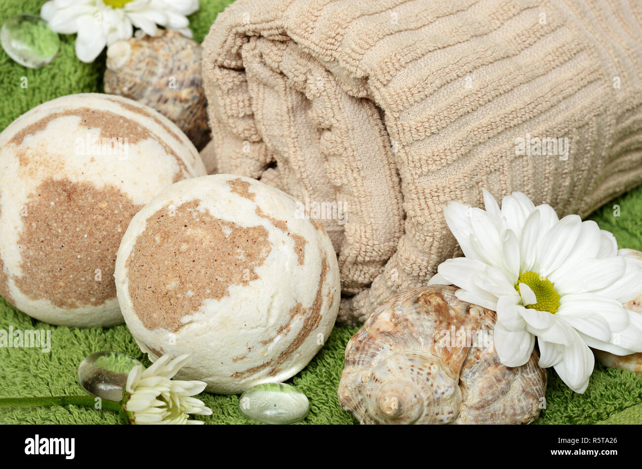 Towel and bath bomb for relaxation - Stock Image