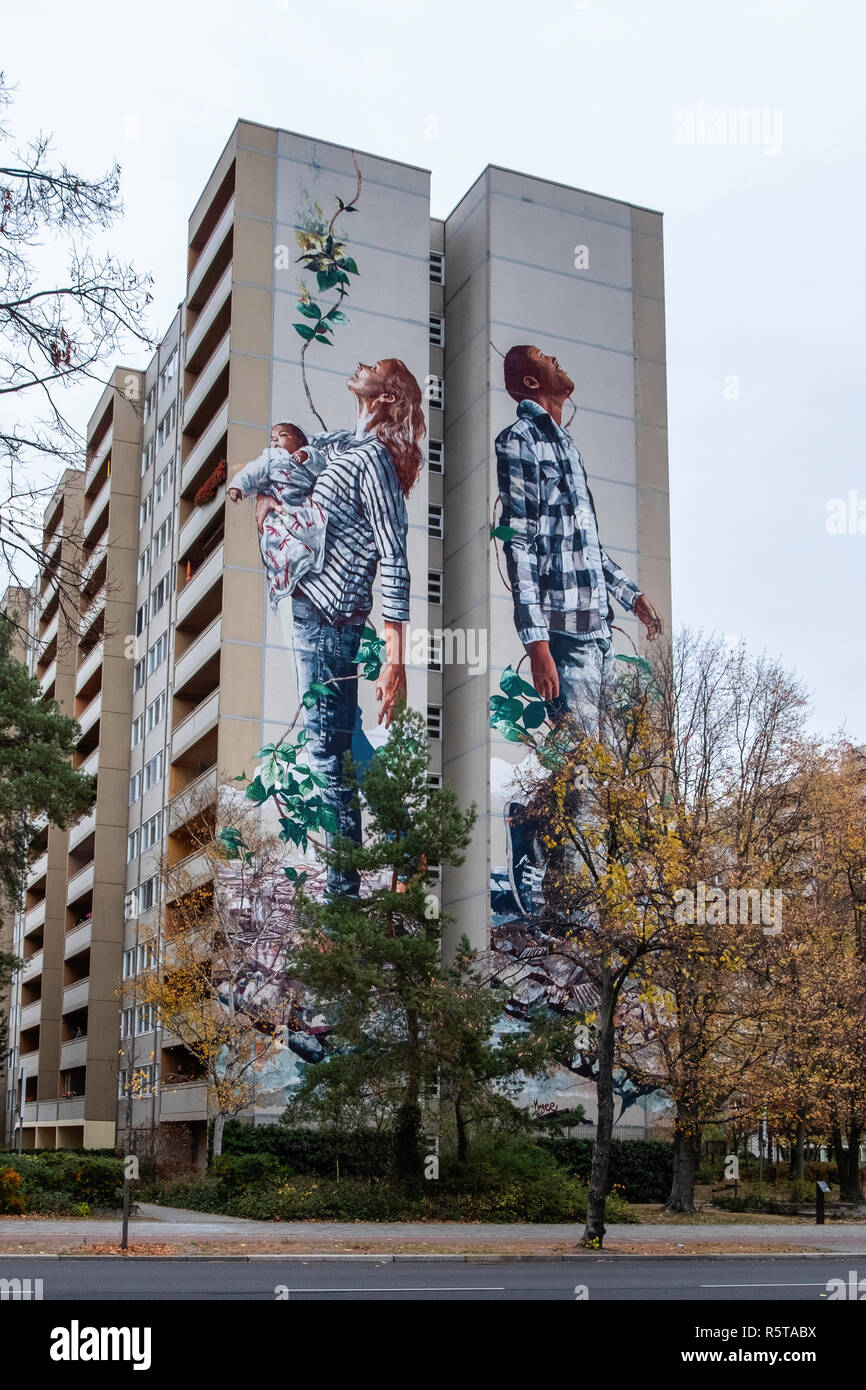 Berlin, Art Park Tegel. Artwork, the Circle of Life by Australian urban artist, Fintan Magee on apartment building. - Stock Image