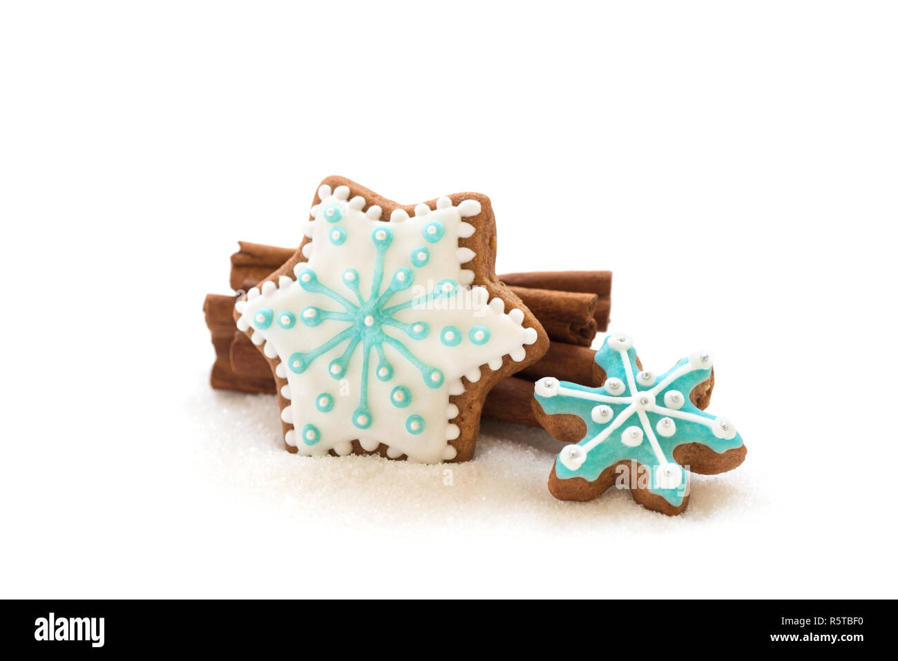 Christmas dekoration with cookies in the shape of snowflakes and stars on a white background - Stock Image
