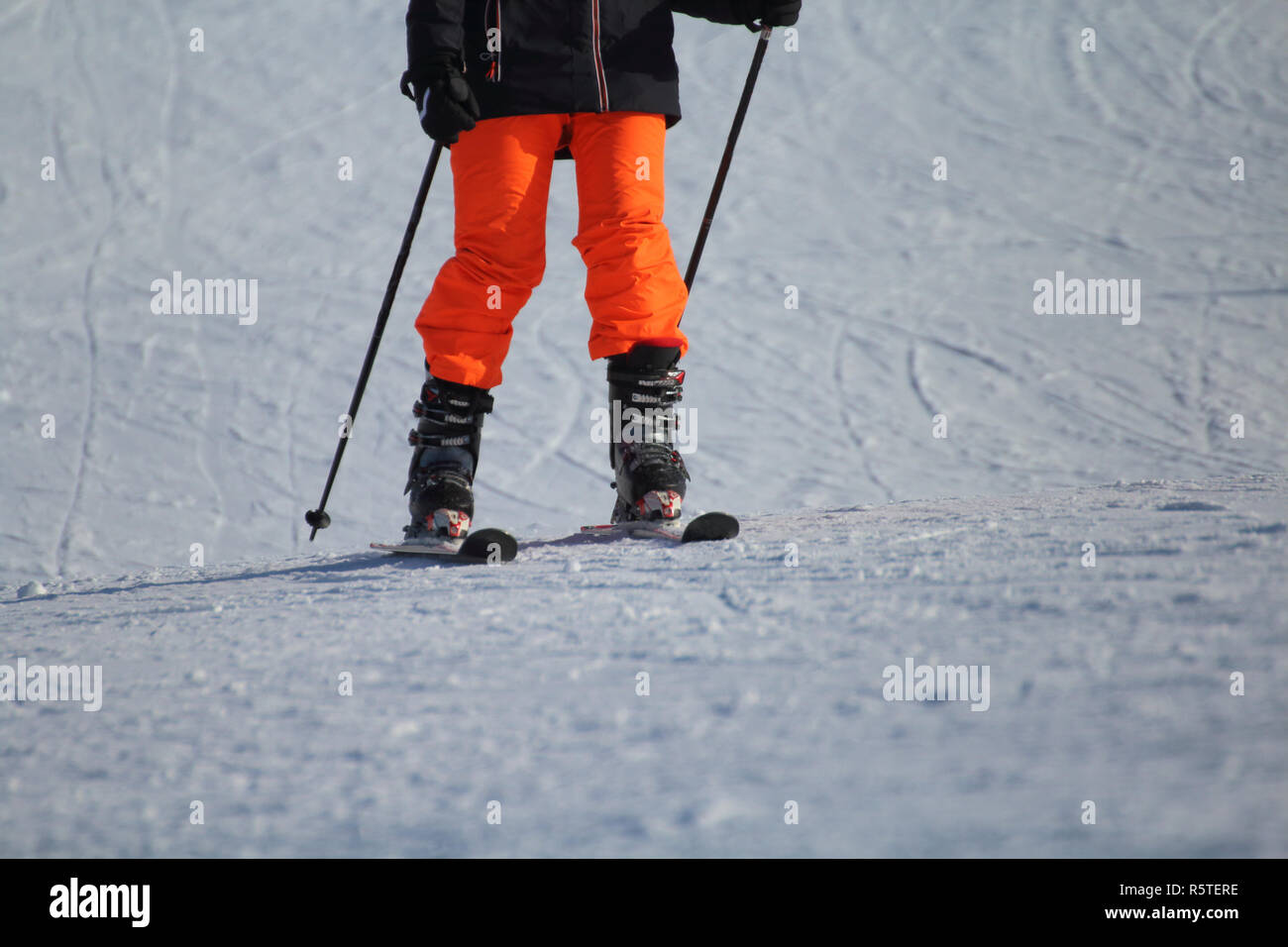 a ski athlete arrives at the end of the descent - Stock Image