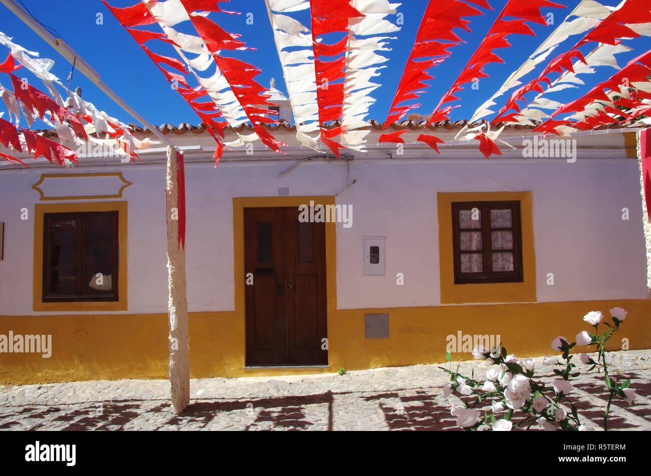 yellow houses in Redondo village, Portugal Stock Photo