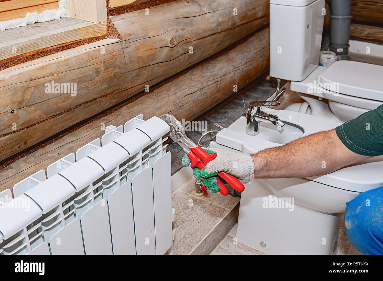 Repair of premises, valve replacement on the battery. Plumbing close-up, manual faucet crimper. Stock Photo