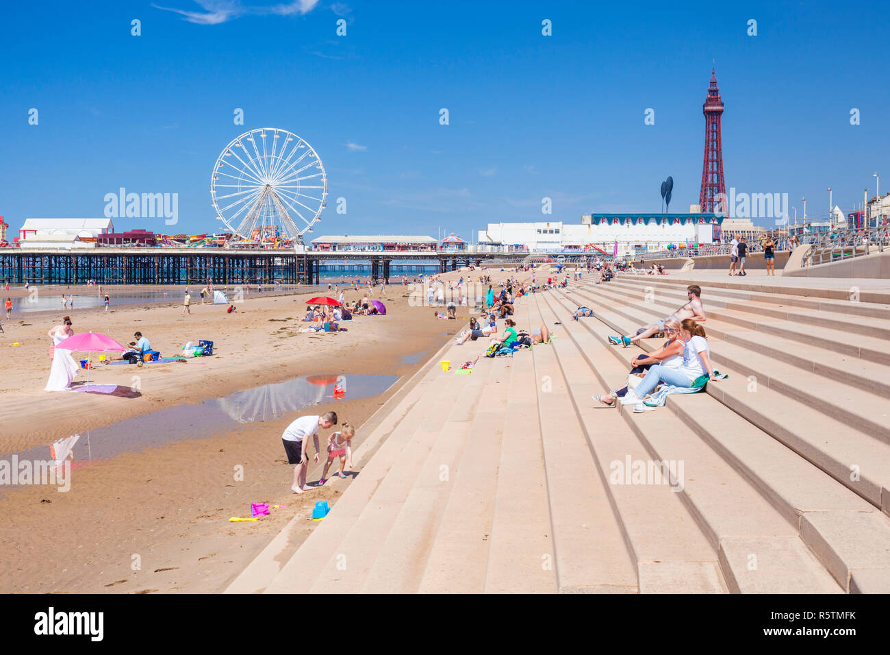 Blackpool beach summer Blackpool tower and central pier Blackpool uk with people on the sandy beach Blackpool Lancashire England UK GB Europe - Stock Image