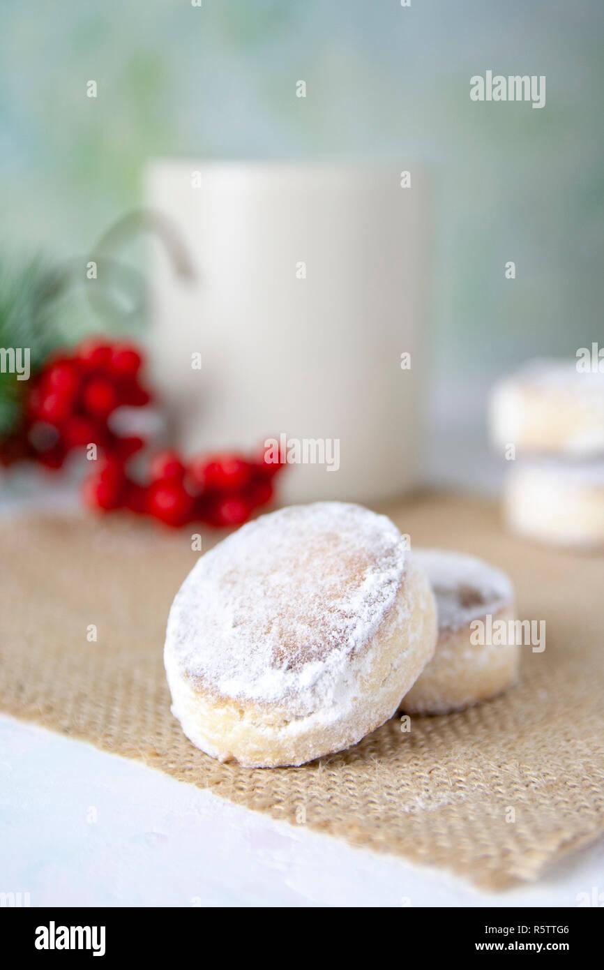 Close-up christmas spanish sweets and a mug. Polvorones.tif - Stock Image