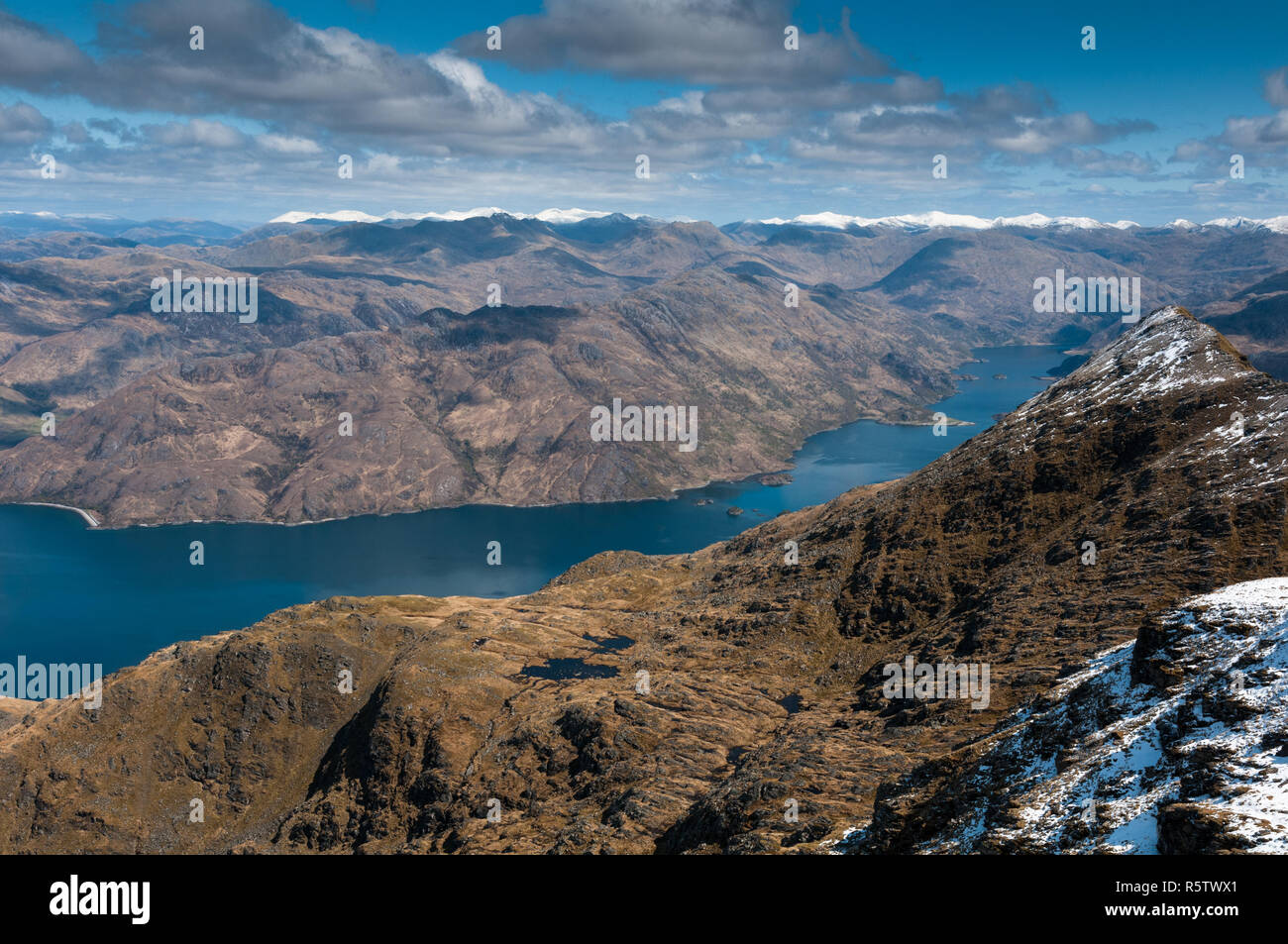 Loch Hourn and the snow-capped mountains of Glenshiel from Ladhar Bheinn, Scotland Stock Photo