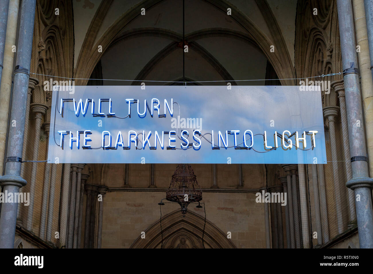 I will turn the darkness into light banner at the entrance to Salisbury Cathedral - Stock Image