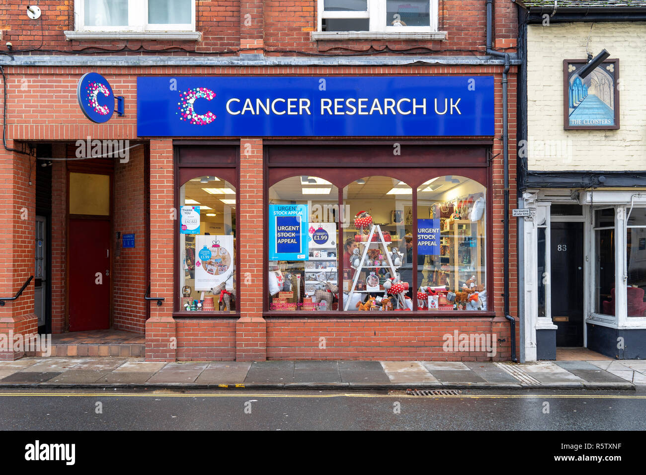 Cancer research charity shop window - Stock Image