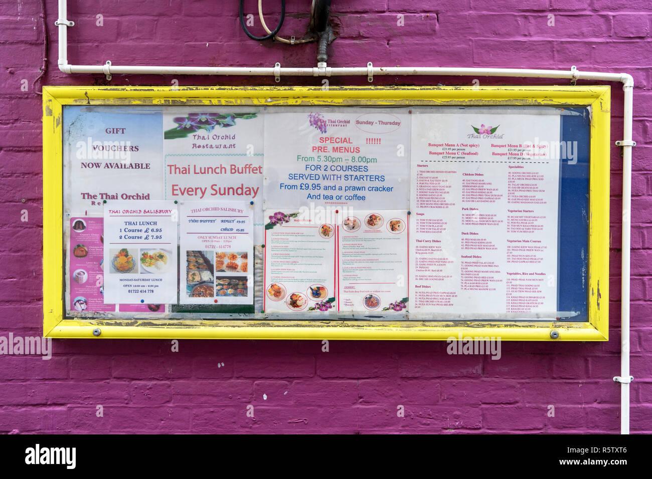 Thai restaurant menus board in yellow frame on purple wall - Stock Image