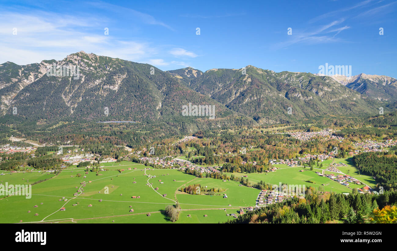 Aerial landscape with green meadow in Alpine valley - Stock Image