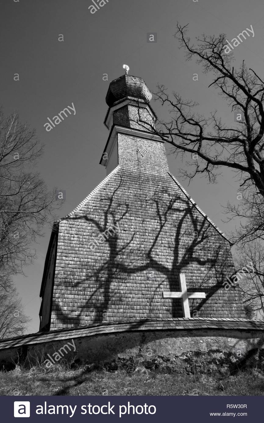 church with cross and dramatic shadows - Stock Image
