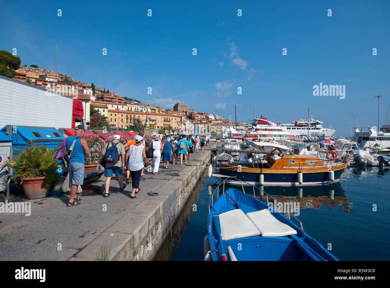 Queue of tourists boarding a ferry boat at Porto Santo Stefano, Grosseto, Tuscany, Italy - Stock Image