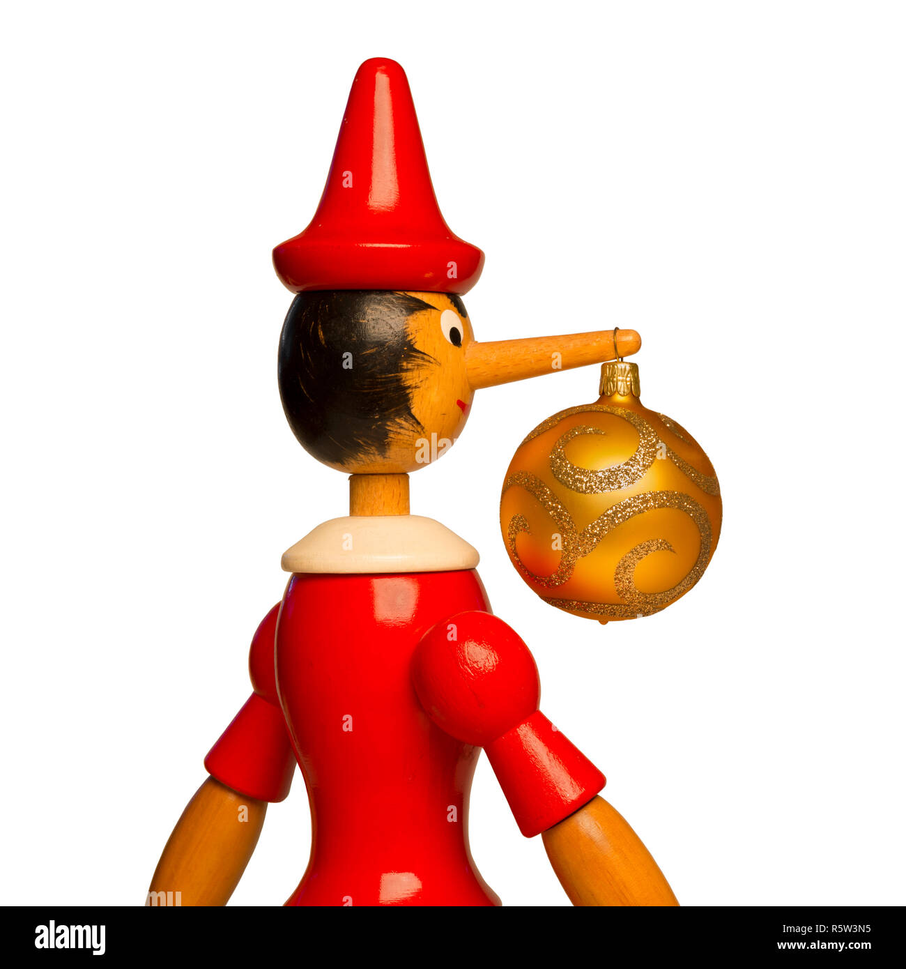 Pinocchio and golden Xmas ball isolated on a white background. Stock Photo