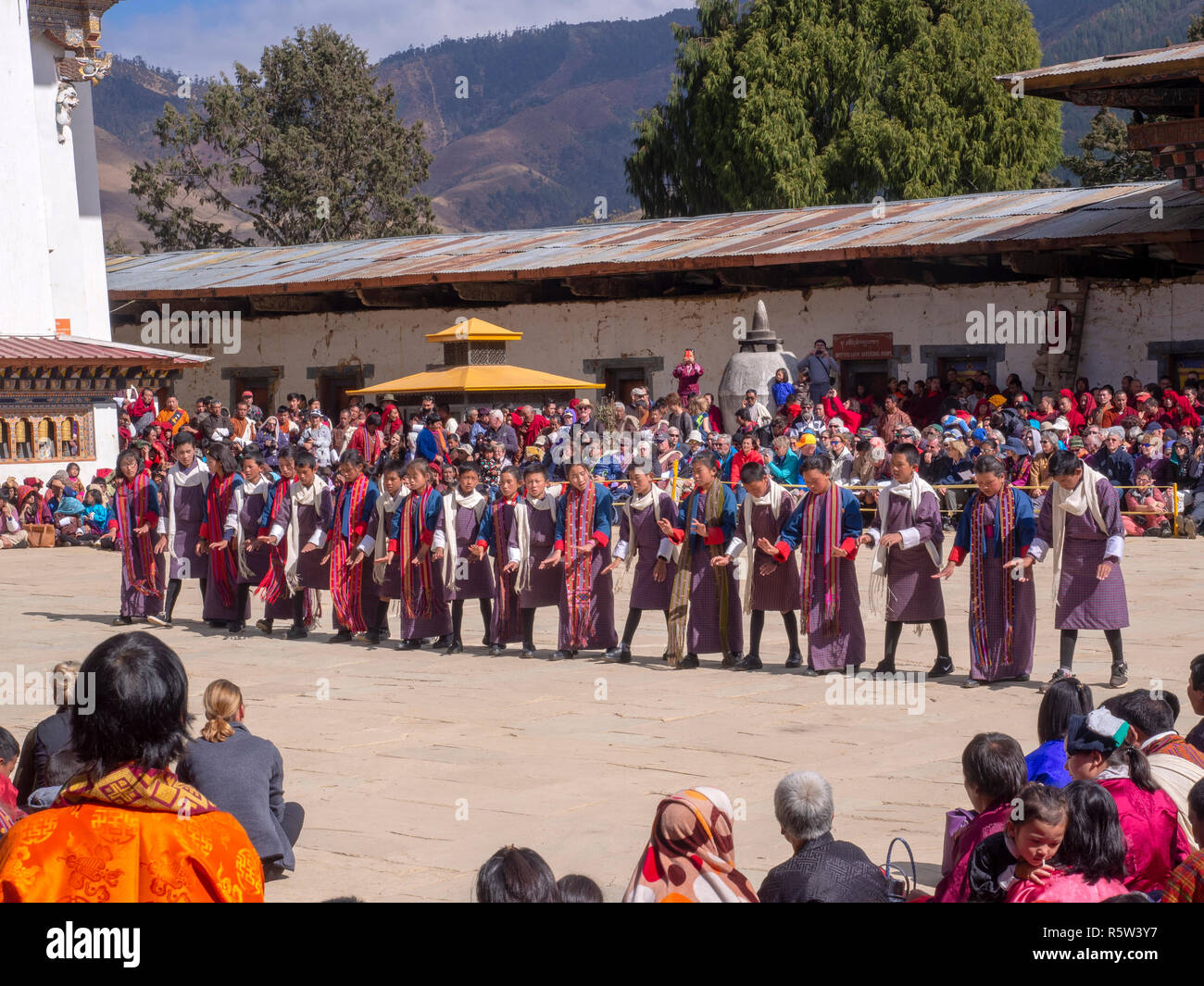Local people watching dancers at the Black-necked Crane Festival in Gangtey, Bhutan - Stock Image