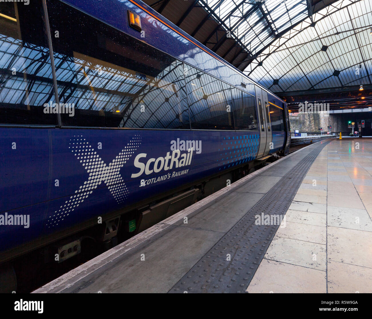 A Scotrail class 170 Turbostar train at Glasgow Queen street showing the Scotrail, Scotland's railway logo - Stock Image