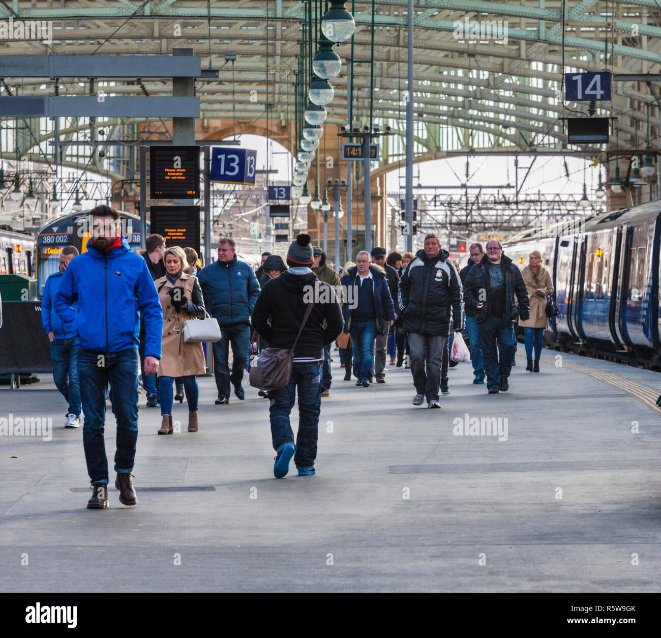 passengers leaving a Scotrail train at Glasgow central railway station - Stock Image