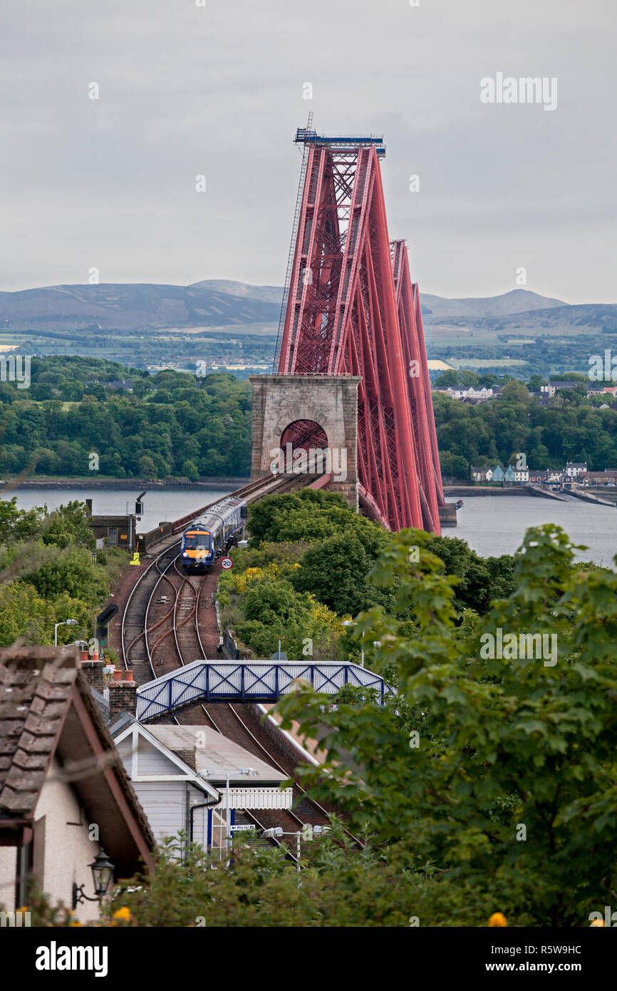 A Scotrail class 170 turbostar train at North Queensferry, leaving the  Forth rail Bridge heading north - Stock Image