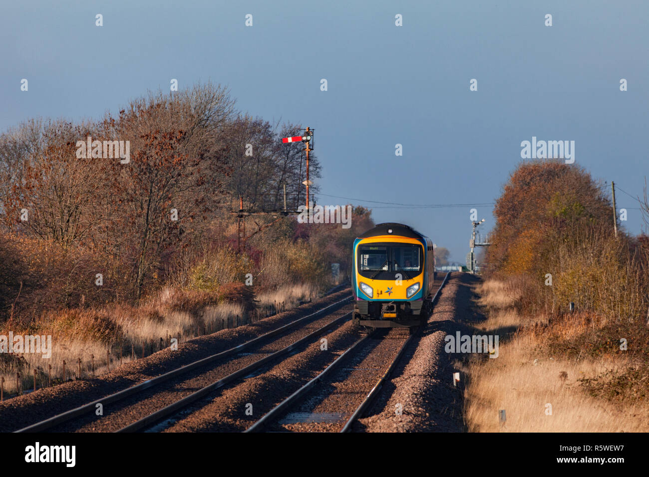 First Transpennine Express class 185 train passing the mechanical bracket semaphore signal at Broomfleet, east Yorkshire Stock Photo