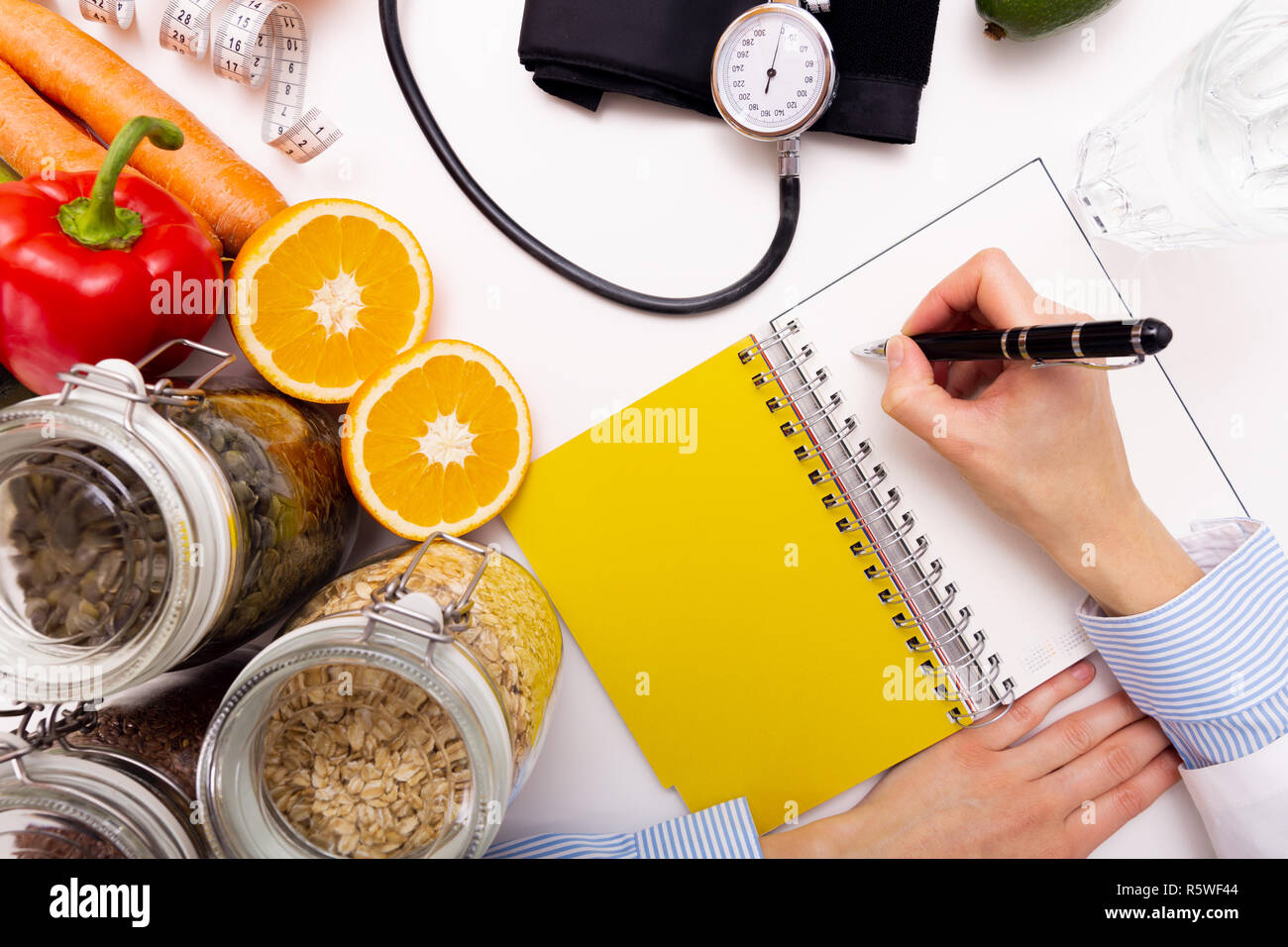 Vegetable diet nutrition and medication concept. Nutritionist offers healthy vegetables diet. Stock Photo
