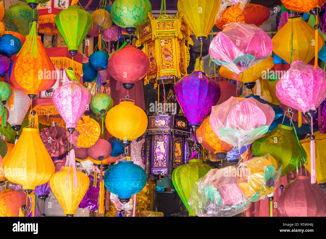 many traditional, colorful lamps hanging in the street shop in Hanoi, Vietnam - Stock Image