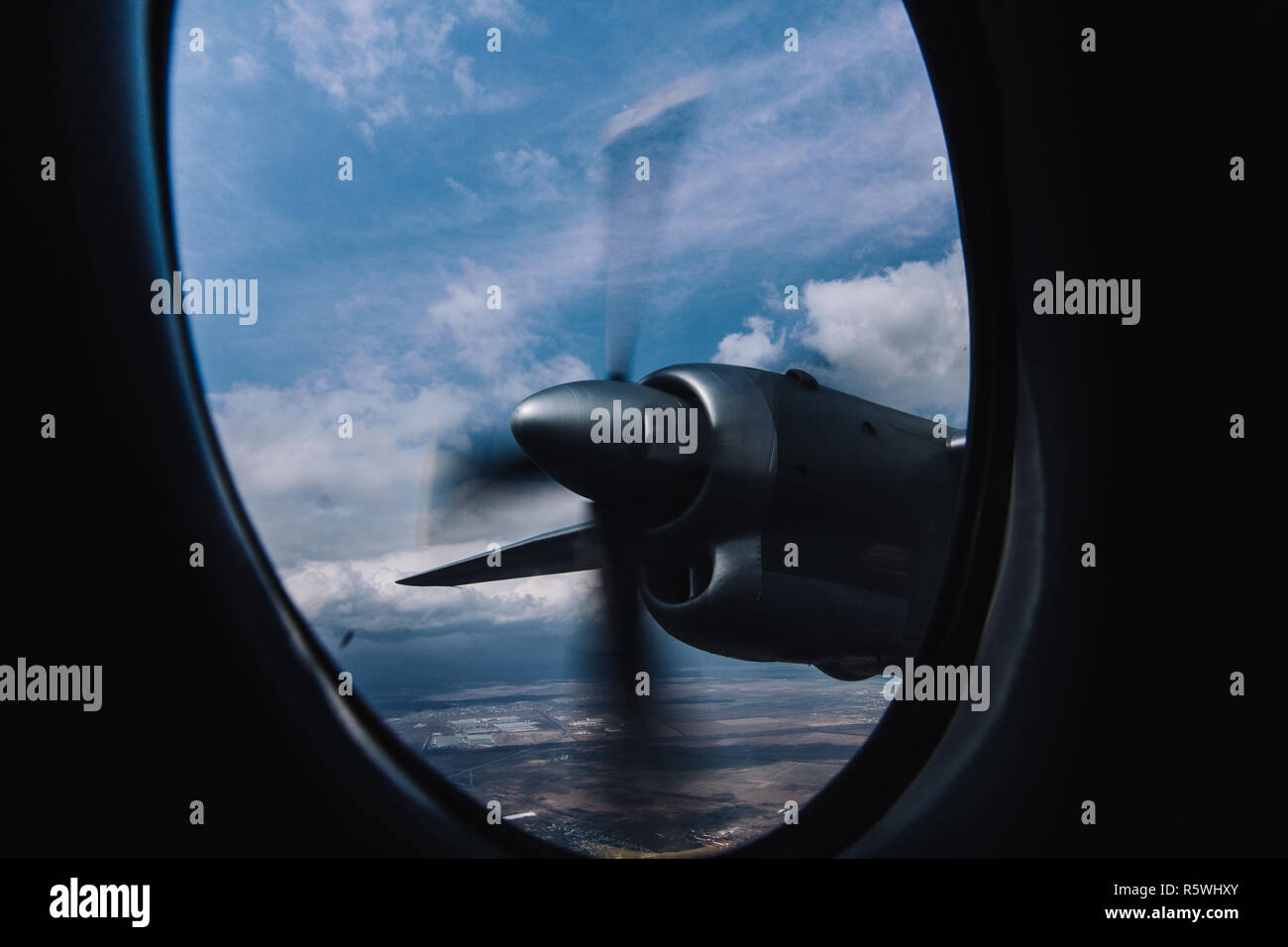 Turboprop engine view from illuminator with aerial bright background - Stock Image
