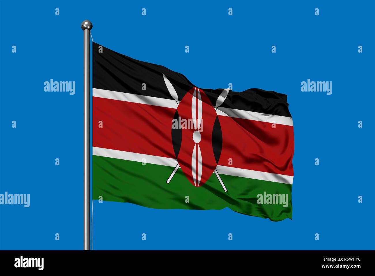 Flag of Kenya waving in the wind against deep blue sky. Kenyan flag. Stock Photo