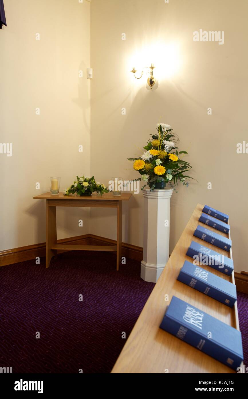 Crematorium chapel with pews and Bibles Stock Photo