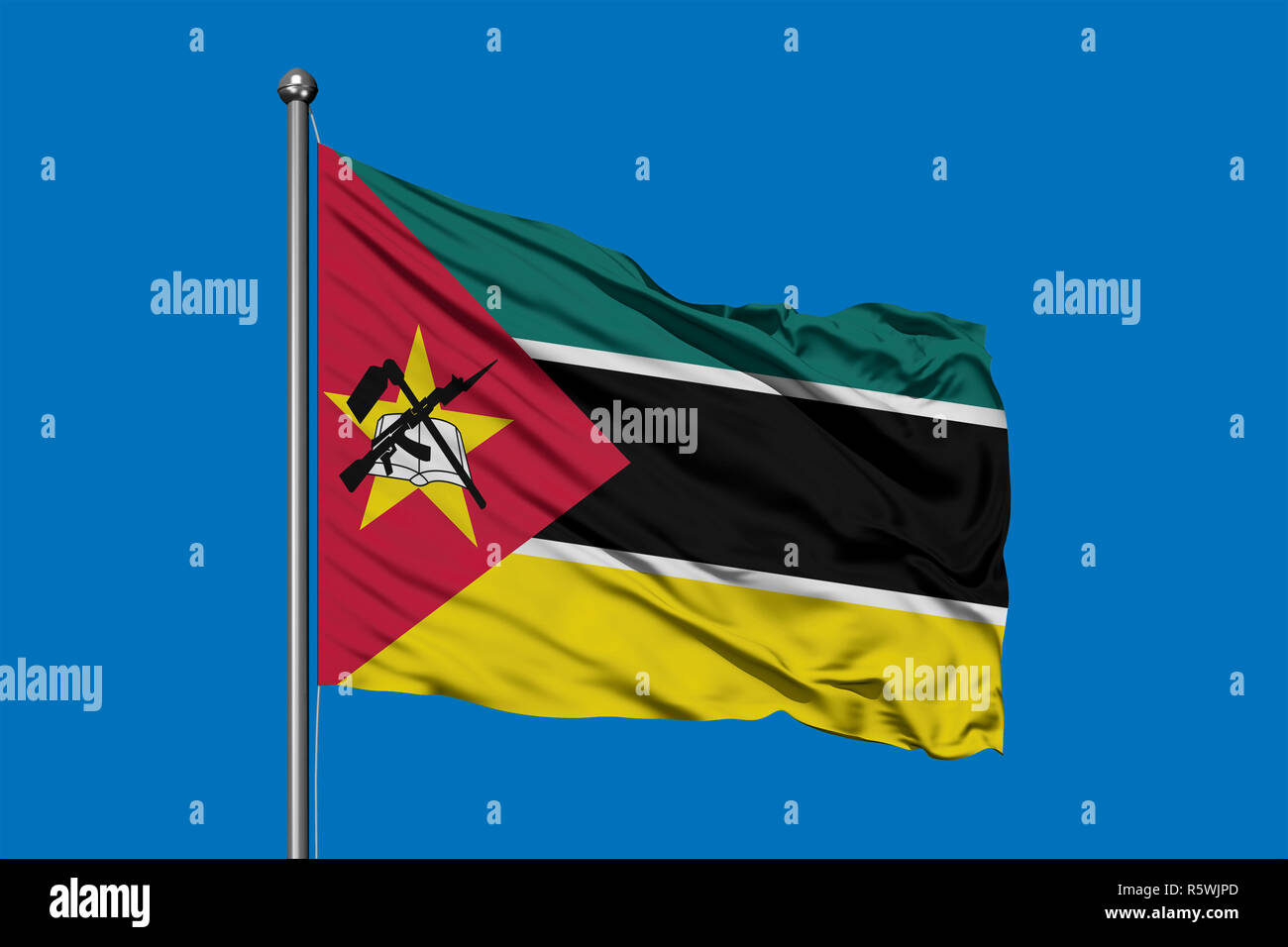 Flag of Mozambique waving in the wind against deep blue sky