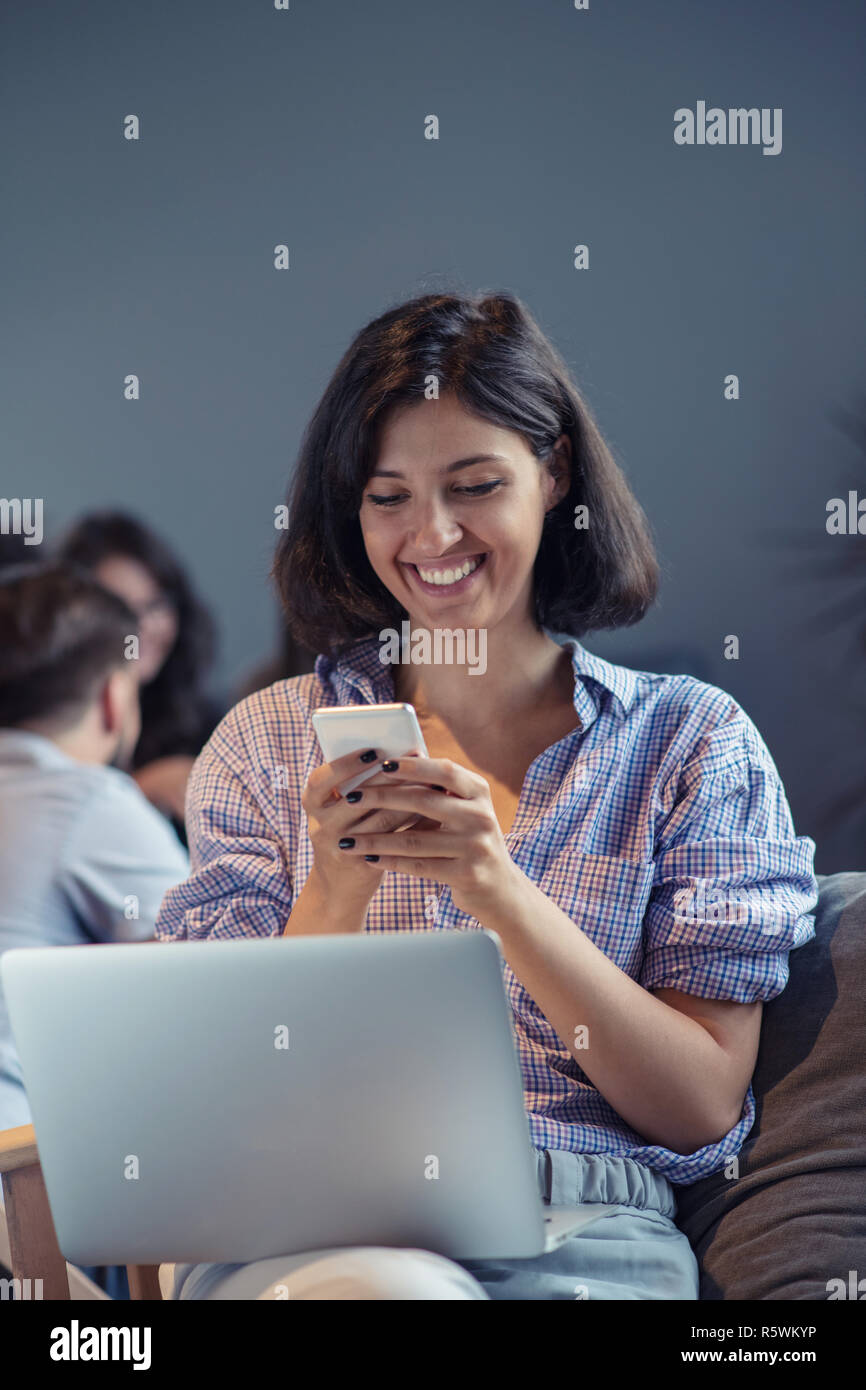 startup business and new mobile technology concept with young multiethnic people working on laptop computer - Stock Image