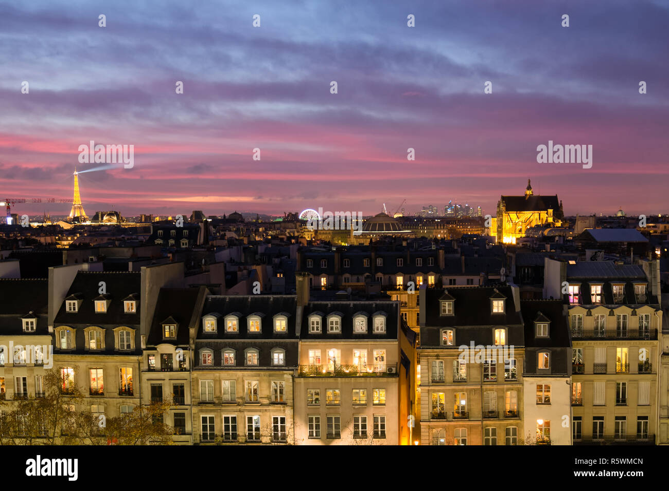 View Of Paris With Classic Architecture In Evening With Glowing Windows And Eiffel Tower Lit At Night During Pink And Purple Sunset Stock Photo Alamy